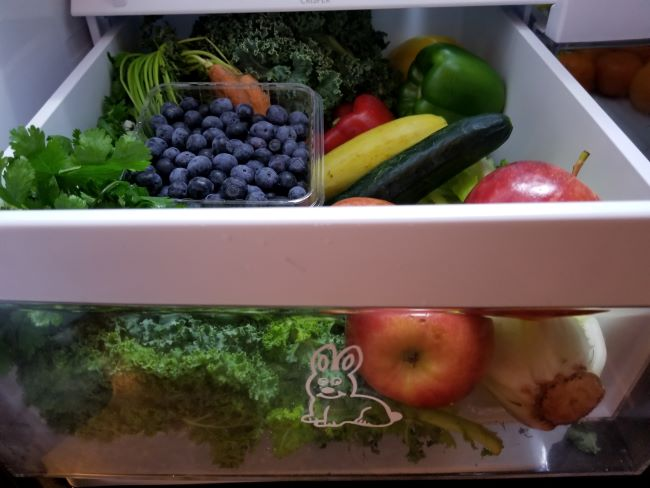 A drawer full of fruits and vegetables as an example of healthy fresh foods for rabbits